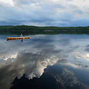 Canoe on a lake in Quetico Provincial park, Ontario.