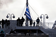 ATHENS, GREECE - FEBRUARY 04: Refugees stand in a ferry arriving to the Pireaus port from the Greek islands on February 04, 2015 in Athens, Greece. Thousands of refugees arrive every day by ferries fleet by private companies from the Greek islands to the Pireaus port. Photo: © Omar Havana. All Rights Are Reserved