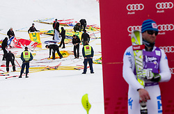 Workers cleaning during flower ceremony after the 2nd Run of Men's Slalom - Pokal Vitranc 2012 of FIS Alpine Ski World Cup 2011/2012, on March 11, 2012 in Vitranc, Kranjska Gora, Slovenia.  (Photo By Vid Ponikvar / Sportida.com)
