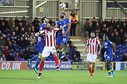 AFC Wimbledon midfielder Tom Soares (19) battles for possession with Lincoln City midfielder Michael Bostwick (16) during the The FA Cup match between AFC Wimbledon and Lincoln City at the Cherry Red Records Stadium, Kingston, England on 4 November 2017. Photo by Matthew Redman.