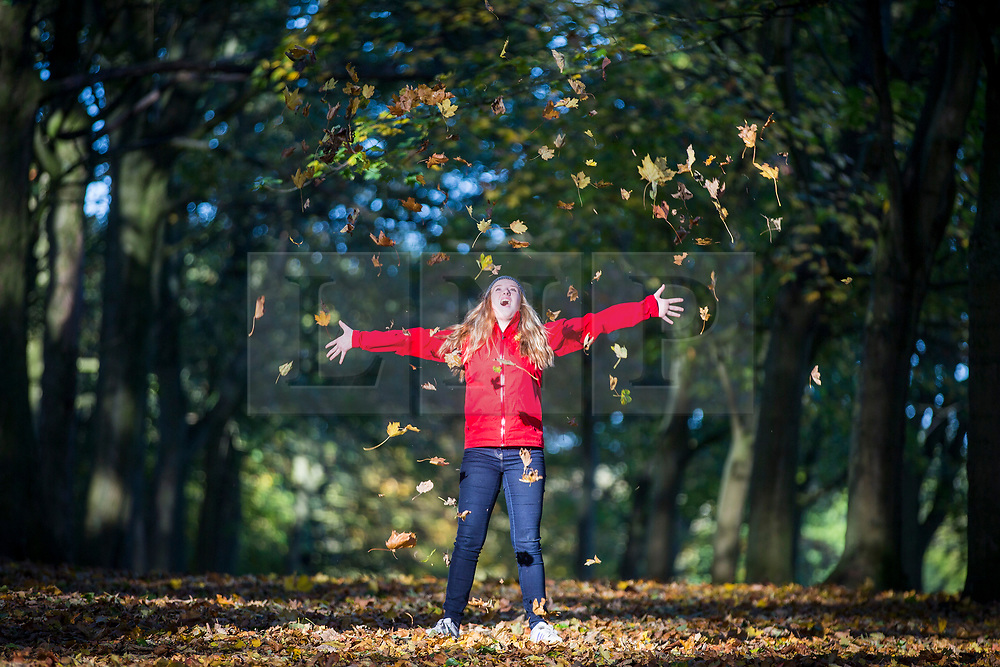 CAPTION CORRECTION <br /> © Licensed to London News Pictures. 22/10/2018. Leeds UK. 13 year old Cerys plays in the leaves at Temple Newsam park in Leeds this morning on a sunny start to the day in Yorkshire. Photo credit: Andrew McCaren/LNP