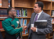Student JoJo Mill Graves, left, talks with Acting US Secretary of Education John King, right, following a roundtable discussion at Sharpstown High School, January 15, 2016.