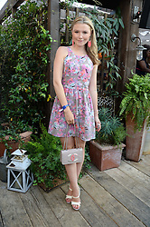 AMBER ATHERTON attending the Warner Bros. & Esquire Summer Party held at Shoreditch House, Ebor Street, London E1 on 18th July 2013.