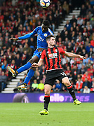 Wilfred Ndidi (25) of Leicester City and Lewis Cook (16) of AFC Bournemouth battles for possession during the Premier League match between Bournemouth and Leicester City at the Vitality Stadium, Bournemouth, England on 30 September 2017. Photo by Graham Hunt.