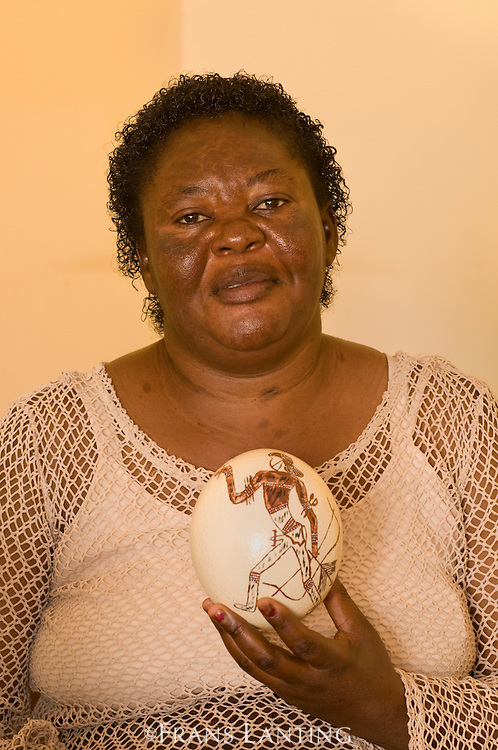 Woman with painted ostrich egg, Tsiseb Conservancy Craft Center, Uis, Brandberg, Damaraland, Namibia