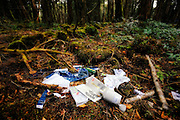 A variety of items, including clothes, empty liquor bottles and the empty packs of prescription pills, are scattered near the base of a tree in Aokigahara Jukai, better known as the Mt. Fuji suicide forest, which is located at the base of Japan's famed mountain west of Tokyo, Japan. ...