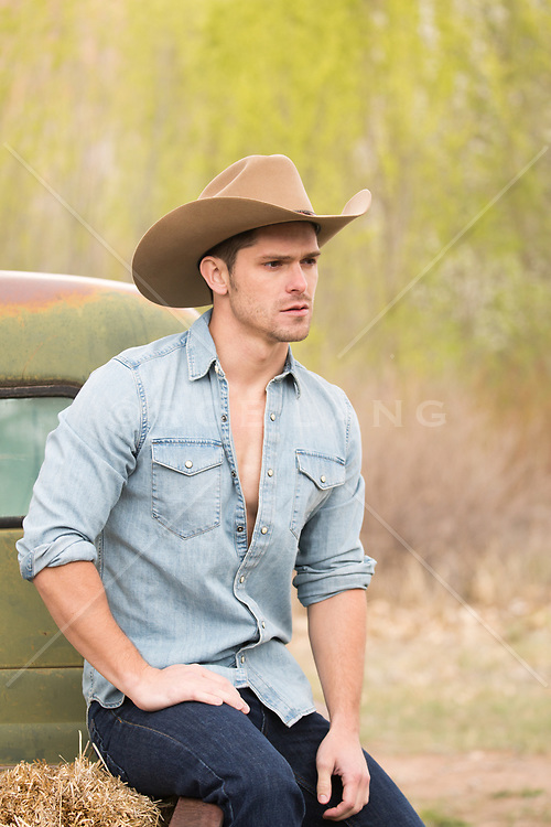 cowboy by a pick up truck outdoors