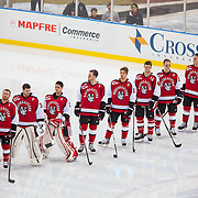 The Northeastern Huskies in action during the Frozen Fenway game between The Northeastern Huskies and The UMass Lowell Riverhawks at Fenway Park on January 11, 2014 in Boston, Massachusetts.