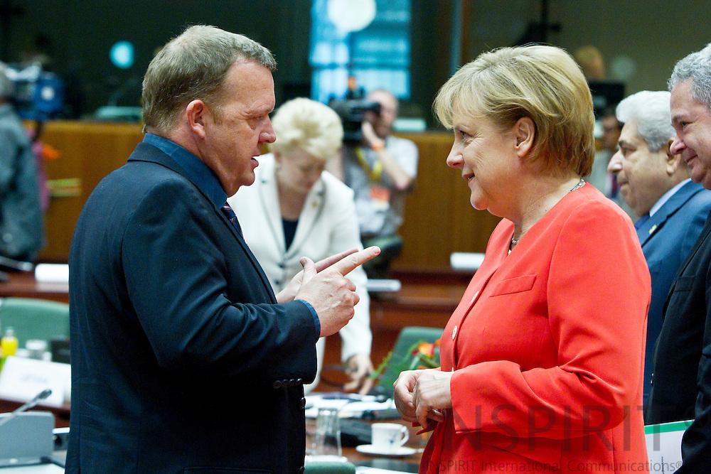 BRUSSELS - BELGIUM - 17 JUNE 2010 -- EU-Summit -- The Danish Prime Minister Lars Loekke Rasmussen talking with the German Federal Chancellor Angela Merkel at the beginning of the EU-summit. PHOTO: ERIK LUNTANG / INSPIRIT Photo