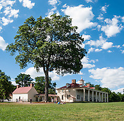 Mount Vernon, Virginia, was the plantation home of George Washington, the first President of the United States (1789-1797). The mansion is built of wood in neoclassical Georgian architectural style on the banks of the Potomac River. Mount Vernon estate was designated a National Historic Landmark in 1960 and is owned and maintained in trust by The Mount Vernon Ladies' Association. The estate served as neutral ground for both sides during the American Civil War, although fighting raged across the nearby countryside. George Washington, who lived 1732-1799, was one of the Founding Fathers of the United States of America (USA), serving as the commander-in-chief of the Continental Army during the American Revolutionary War, and presiding over the convention that drafted the Constitution in 1787. Named in his honor are Washington, D.C. (the District of Columbia, capital of the United States) and the State of Washington on the Pacific Coast. Panorama stitched from 2 overlapping images.
