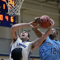 DAILY TIMES - TOM KELLY IV<br /> Cabrini's Sean Mayo (50) has his shot blocked by Immaculata's Mamadou Diakite (12) during the Immaculata at Cabrini men's basketball game on Wednesday, January 7, 2014.