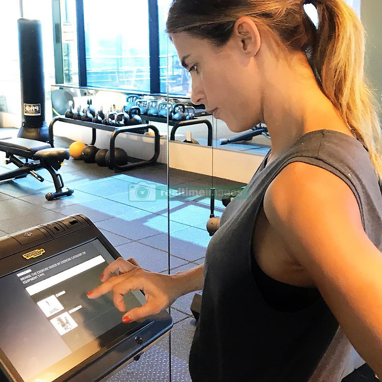 "Elisabetta Canalis releases a photo on Instagram with the following caption: ""Ma che figata allenarsi con l'aiuto del @technogym  #kiosk ! Avete mai provato ? Potete organizzarvi l'allenamento come preferite  sia che siate da soli o  in gruppo tenendo conto dei diversi risultati raggiunti \ud83d\udcaa\ud83c\udffc#itrainwithtechnogym I looove the Technogym kiosk . I can work by myself or in group classes keeping track of the results \ud83d\udcaa\ud83c\udffc\ud83d\udc4c\ud83c\udffb\ud83c\udf89"". Photo Credit: Instagram *** No USA Distribution *** For Editorial Use Only *** Not to be Published in Books or Photo Books ***  Please note: Fees charged by the agency are for the agency's services only, and do not, nor are they intended to, convey to the user any ownership of Copyright or License in the material. The agency does not claim any ownership including but not limited to Copyright or License in the attached material. By publishing this material you expressly agree to indemnify and to hold the agency and its directors, shareholders and employees harmless from any loss, claims, damages, demands, expenses (including legal fees), or any causes of action or allegation against the agency arising out of or connected in any way with publication of the material."