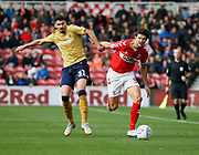 Middlesbrough defender George Friend (3) goes past Nottingham Forest forward Gil Dias (31)  during the EFL Sky Bet Championship match between Middlesbrough and Nottingham Forest at the Riverside Stadium, Middlesbrough, England on 6 October 2018.