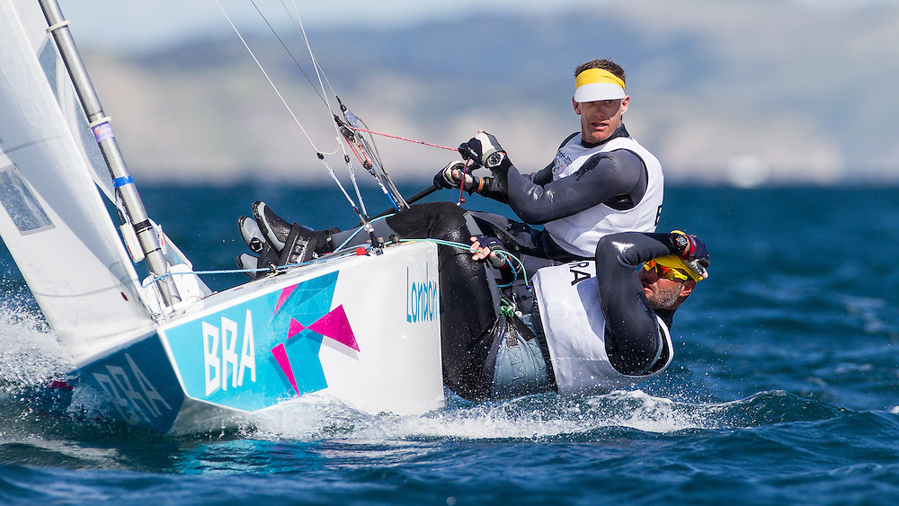 ENGLAND, Weymouth. 29th July 2012. Olympic Games. Star class, Race 2. Robert Scheidt (BRA) Helm, Bruno Prada (BRA) Crew.