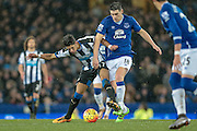 Gareth Barry (Everton) and Ayoze Perez (Newcastle United) tussling for the ball during the Barclays Premier League match between Everton and Newcastle United at Goodison Park, Liverpool, England on 3 February 2016. Photo by Mark P Doherty.