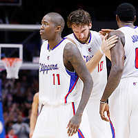 17 October 2014: Los Angeles Clippers guard Jamal Crawford (11), Los Angeles Clippers forward Spencer Hawes (10) and Los Angeles Clippers center DeAndre Jordan (6) celebrate during the Los Angeles Clippers 101-97 victory over the Utah Jazz, in a preseason game, at the Staples Center, Los Angeles, California, USA.