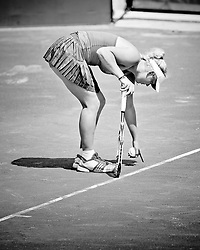 Caroline Wozniacki points to a mark on the court while debating a call during the 2011 Family Circle Cup at Daniel Island.
