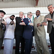 International Boxing Hall of Fame inductees for 2012 (from left) Michael Katz, Mark Johnson, Al Bernstein, Freddie Roach, Thomas Hearns and Michael Buffer show their rings during the 23rd Annual Induction ceremony  at the International Boxing Hall of Fame on Sunday, June 10, 2012 in Canastota, NY. (AP Photo/Alex Menendez)