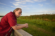 South Merrick, New York, USA - September 7, 2014 - Bob Stuhmer at Norman J Levy Park and Preserve marshland, during a pleasant late summer day on Long Island, New York.