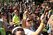Ohio University's 2013 freshman class watches and takes pictures of Marching 110 before the Campus Involvement Fair in Athens, Ohio on Sunday, August 25, 2013. Photo by Chris Franz