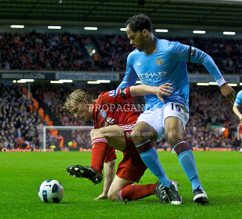 LIVERPOOL, ENGLAND - Monday, April 11, 2011: Liverpool's Dirk Kuyt and Manchester City's Joleon Lescott during the Premiership match at Anfield. (Photo by David Rawcliffe/Propaganda)