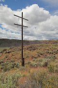 A crumbling old abandoned power pole in the desert of Central Washington.