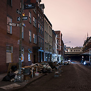 November 2, 2012 - New York, NY : Lower Manhattan soldiered through it's fourth consecutive night without electricity in the wake of Super Storm Sandy. Pictured here, a minute-long exposure captures Beekman Street at Water Street -- mounds of water-damanged furniture and household items left on the curb -- early on Friday morning. CREDIT: Karsten Moran