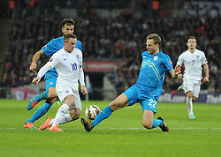 Ales Mertelj of Slovenia tackles Wayne Rooney of England (Manchester United) - Photo mandatory by-line: Alex James/JMP - Mobile: 07966 386802 - 15/11/2014 - SPORT - Football - London - Wembley - England v Slovenia - EURO 2016 Qualifier
