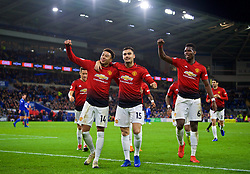 CARDIFF, WALES - Saturday, December 22, 2018: Manchester United's Jesse Lingard (L) celebrates with team-mates Andreas Pereira (C) and Paul Pogba (R) after the FA Premier League match between Cardiff City FC and Manchester United FC at the Cardiff City Stadium. Manchester United won 5-1.(Pic by Vegard Grøtt/Propaganda)