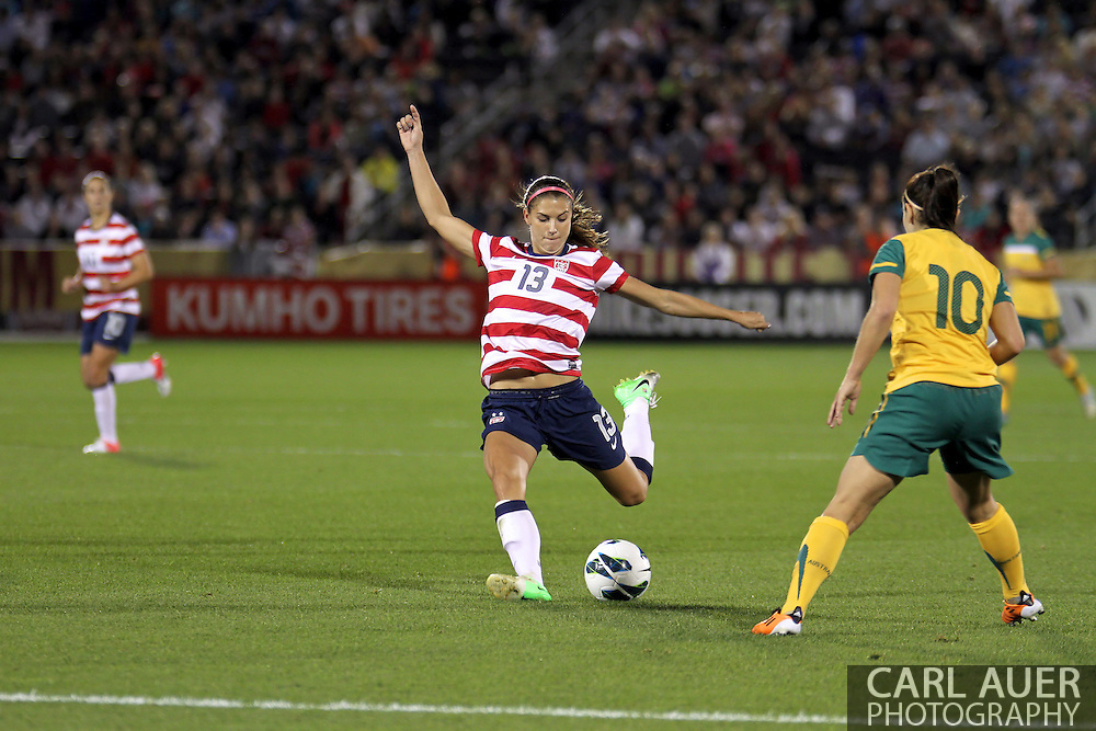September 19, 2012 Commerce City, CO.  USA f Alex Morgan (13) takes a shot during the Soccer Match between the USA Women's National Team and the Women's Australian team at Dick's Sporting Goods Park in Commerce City, Colorado