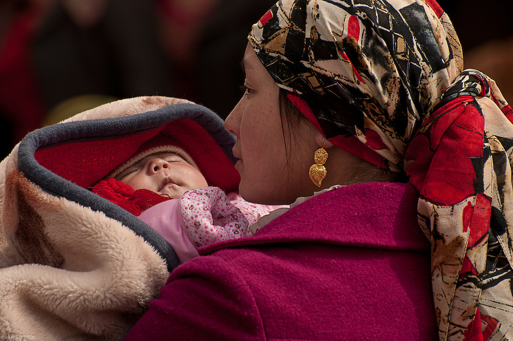 — A Uyghur mother and her newborn visiting the Kashgar open-market.