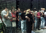 Reflections of visitors to the Vietman Memorial.