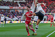 Fulham defender Dan Burn clears the ball from Middlesbrough FC striker David Nugent during the Sky Bet Championship match between Middlesbrough and Fulham at the Riverside Stadium, Middlesbrough, England on 17 October 2015. Photo by George Ledger.