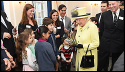 Image ©Licensed to i-Images Picture Agency. 01/12/2016. London, United Kingdom. The Queen Visits Goodenough college. <br /> <br /> Queen Elizabeth II meets members of Goodenough College during a visit on December 1, 2016 in London, England.  Goodenough College is the leading residential community for British and international postgraduate students studying in London.<br /> <br /> <br /> Picture by i-Images / Pool