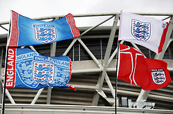 England flags wave in the breeze outside the ground before the international friendly match at Wembley Stadium, London.