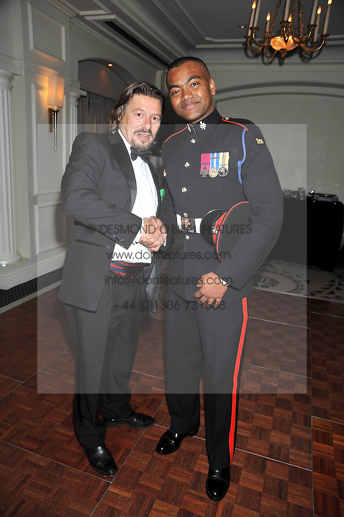 Left to right,  ROBERT LAWRENCE MC and JOHNSON BEHARRY VC at the Matterhorn Challenge Ball in aid of Combat Stress as part of their 90th anniversary celebrations held at The Berkeley Hotel, London on 11th June 2009.