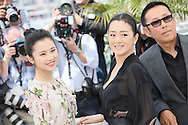 "CANNES, FRANCE - MAY 20:  Huiwen Zhang, Daoming Chen and Gong Li attend the ""Coming Home"" photocall at the 67th Annual Cannes Film Festival on May 20, 2014 in Cannes, France.  (Photo by Tony Barson/FilmMagic)"