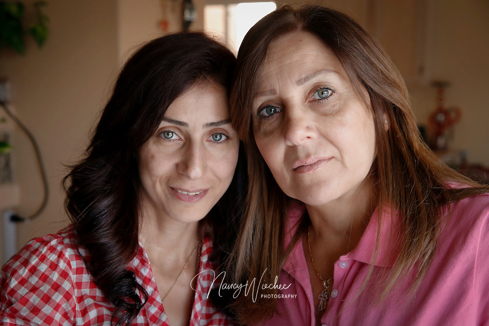 Chaldean Catholics Victoria Marzana and her daughter, Zinah, are pictured at home in Gilbert, Arizona. Zinah was severely injured and her husband died in Iraq when they were shot by a motorist from whom they had asked for directions. (Nancy Wiechec for ONE magazine)