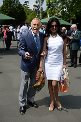 © Licensed to London News Pictures. 24/06/2014. London, UK . Wimbledon Tennis Championships 2014<br /> Day 2. Sir Bruce Forsyth & wife Wilnelia Merced .  Photo credit : Mike King/LNP