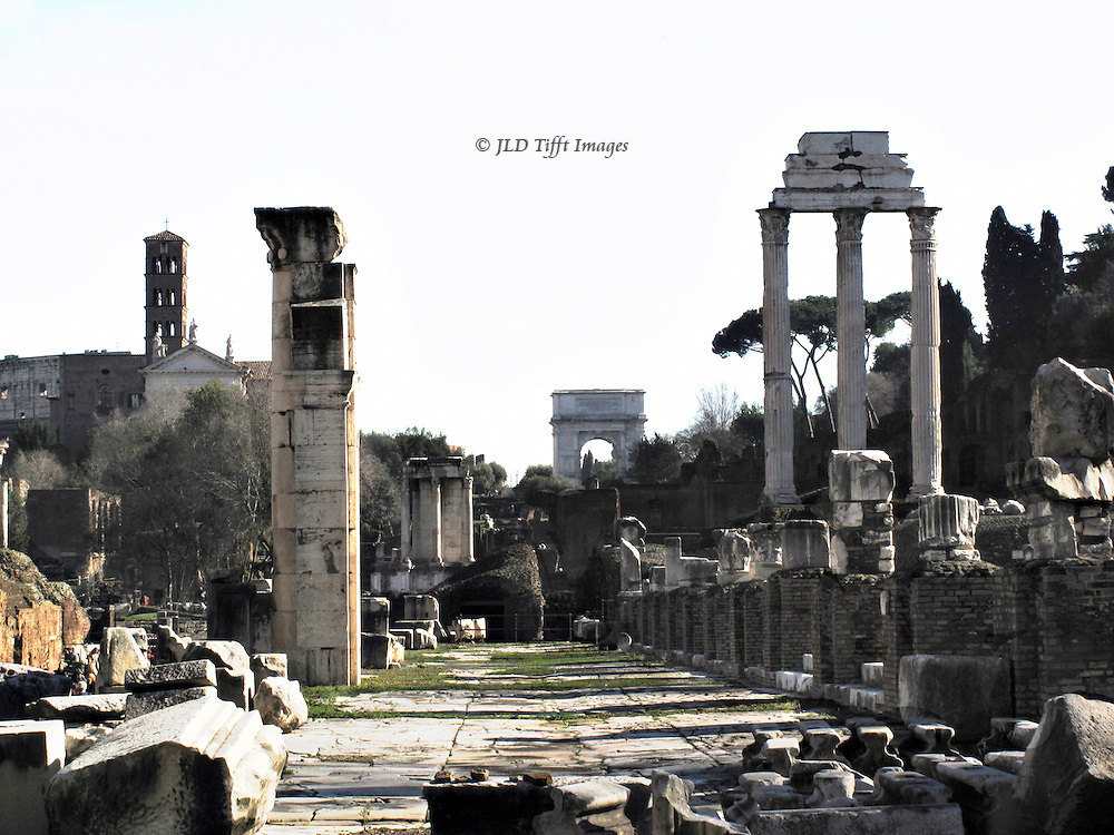 Roman Forum, looking along the main street (Via Sacra)  toward the Arch of Titus.