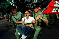 A member of the Hong Kong Federation of Students is carried away by the polices while staging a sit-in on outside Central Government Office building. Hong Kong (1991)