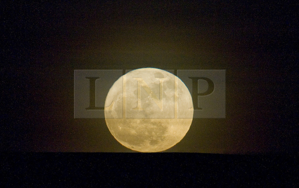 """© under license to London News Pictures. .Photos by Ian Forsyth. March 19, 2011..A full moon rises over Huntcliff at Saltburn by the Sea in Cleveland that today will appear to be the biggest in almost 20 years. ..Called a """"perigee moon,""""  this moon rise is a rare celestial event that occurs when the moon reaches the closest possible point of its orbit around the earth, about 212,000 miles away...Photo credit should read Ian Forsyth/LNP"""