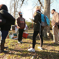 Volunteers talk with a homeless man Tuesday morning near the Lee County Library as past of the yearly homeless census.