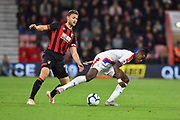 Wilfried Zaha (11) of Crystal Palace is challenged by Simon Francis (2) of AFC Bournemouth during the Premier League match between Bournemouth and Crystal Palace at the Vitality Stadium, Bournemouth, England on 1 October 2018.
