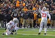 November 20 2010: Ohio State Buckeyes kicker Devin Barclay (23) eyes the goal post as Ohio State Buckeyes holder Joe Bauserman (14) looks on during the second quarter of the NCAA football game between the Ohio State Buckeyes and the Iowa Hawkeyes at Kinnick Stadium in Iowa City, Iowa on Saturday November 20, 2010. Ohio State defeated Iowa 20-17.