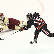 Kevin Roy #15 of the Northeastern Huskies shoots the puck during The Beanpot Championship Game at TD Garden on February 10, 2014 in Boston, Massachusetts. (Photo by Elan Kawesch)