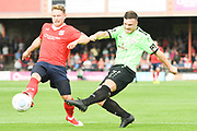 Joe Guest of Curzon Ashton (7) shoots during the Vanarama National League North match between York City and Curzon Ashton at Bootham Crescent, York, England on 18 August 2018.