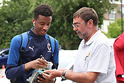 AFC Wimbledon goalkeeper Nathan Trott (1) signing autograph during the Pre-Season Friendly match between AFC Wimbledon and Bristol City at the Cherry Red Records Stadium, Kingston, England on 9 July 2019.