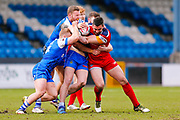 Halifax RLFC  try to stop London Broncos second row William Lovell (21)  during the Betfred Championship match between Halifax RLFC and London Broncos at the MBi Shay Stadium, Halifax, United Kingdom on 8 April 2018. Picture by Simon Davies.