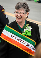 Goshen, New York - Grand Marshall Sister Ann Daly smiles as she heads to the reviewing stand on Main Street during the 40th annual Mid-Hudson St. Patrick's Parade  on March 13, 2016.